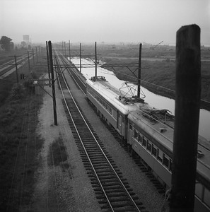 2018.008.CSSSB.I.014--bruce meyer 120 neg--CSS&SB--electric interurban westbound passenger train at 130th and Stony Island scene--Chicago IL--1958 0623