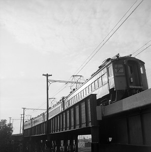 2018.008.CSSSB.I.007--bruce meyer 120 neg--CSS&SB--electric interurban eastbound passenger train crossing bridge at 130th and Torrence--Chicago IL--1958 0623