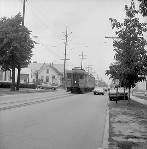 2018.008.CSSSB.I.049--bruce meyer 120 neg--CSS&SB--electric interurban 107 on eastbound passenger train street running--Michigan City IN--1979 0828