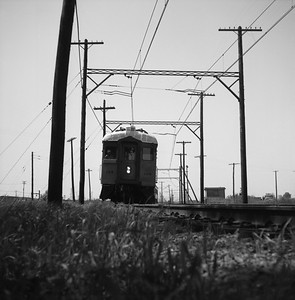 2018.008.CSSSB.I.001--bruce meyer 120 neg--CSS&SB--electric interurban eastbound passenger train at State Line Tower--Hammond IN--1958 0529