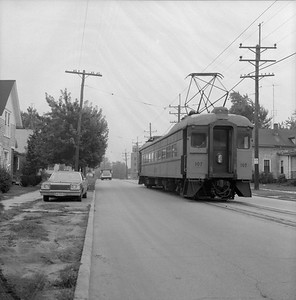 2018.008.CSSSB.I.051--bruce meyer 120 neg--CSS&SB--electric interurban 107 on eastbound passenger train street running--Michigan City IN--1979 0828