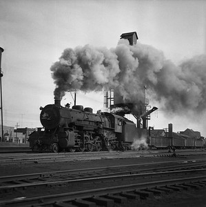 2018.008.CSPMO.S.007--bruce meyer 120 neg--CStPM&O--steam locomotive 2-8-2 J-A 411 with freight cars action--Spooner WI--1955 0701
