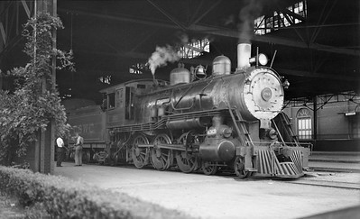 2018.008.CWC.S.01--bruce meyer 116 neg--C&WC--steam locomotive 4-6-0 253 at train shed station--Augusta GA--1932 0903