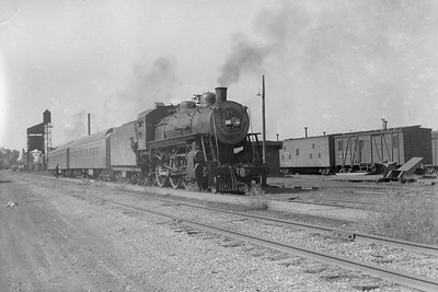 2018.008.CGW.S.12--bruce meyer 6x9 neg--CGW--steam locomotive 4-6-0 E-7 505 on passenger train action--Oelwein IA--1948 0000