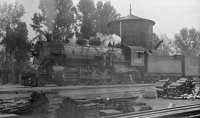 2018.008.CGW.S.32--bruce meyer 116 neg [Ed Leinhard]--CGW--steam locomotive 2-8-2 L-1 702 on westbound freight train at York Road--Elmhurst IL--c1938 0000