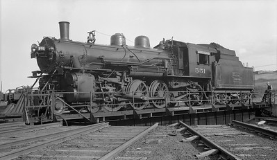 2018.008.DSSA.S.14--bruce meyer 116 neg [John Boose]--DSS&A--steam locomotive 4-6-2 551 on turntable--Marquette MI--1939 0826