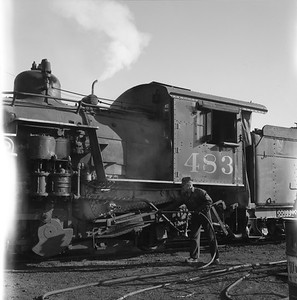 2018.008.DRGW.S.038--bruce meyer 120 neg--D&RGW--narrow gauge steam locomotive 2-8-2 483 being serviced scene--Alamosa CO--1961 0311