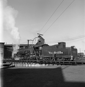 2018.008.DRGW.S.031--bruce meyer 120 neg--D&RGW--narrow gauge steam locomotive 2-8-2 483 on turntable at roundhouse scene--Alamosa CO--1961 0311