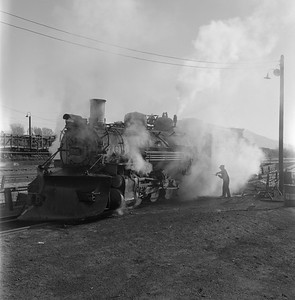 2018.008.DRGW.S.035--bruce meyer 120 neg--D&RGW--narrow gauge steam locomotive 2-8-2 483 being serviced scene--Alamosa CO--1961 0311