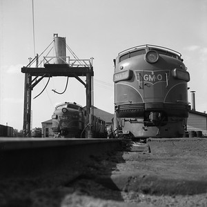2018.008.GMO.D.038--bruce meyer 120 neg--GM&O--EMD diesel locomotive 806A and 805B scene at sand tower--Bloomington IL--1958 0525