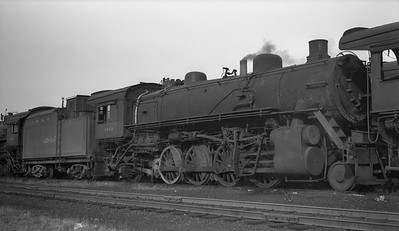 2018.008.GMO.S.114--bruce meyer 116 neg--GM&O--steam locomotive 2-8-2 4353 (retired without tender)--Bloomington IL--1950 0219