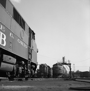 2018.008.GMO.D.041--bruce meyer 120 neg--GM&O--EMD diesel locomotive 802B and ALCO 1501 scene--Bloomington IL--1958 0525