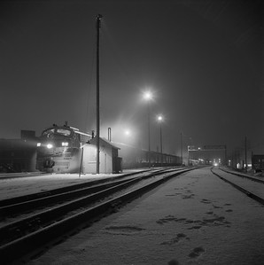 2018.008.IC.PD.01860--bruce meyer 120 neg--ICRR--EMD diesel locomotive 812 (CofG) on southbound passenger train 9 Seminole night scene at station--Champaign IL--1958 1221