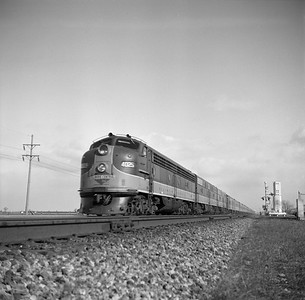 2018.008.IC.PD.00852--bruce meyer 120 neg--ICRR--EMD diesel locomotive 4025 on passenger train City of New Orleans--Gilman IL--1957 0302