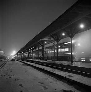 2018.008.IC.PD.01857--bruce meyer 120 neg--ICRR--obs passenger car on hind end of southbound passenger train 5 Panama Limited night scene at station--Champaign IL--1958 1221