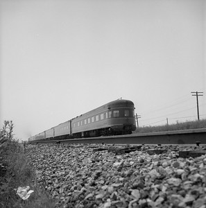 2018.008.IC.PD.02057--bruce meyer 120 neg--ICRR--obs passenger car on hind end of southbound passenger train Daylight--north of Bradley IL--1958 0803