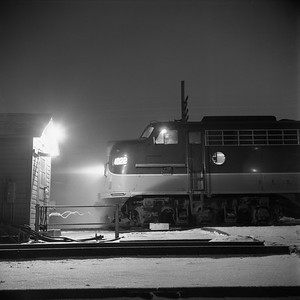 2018.008.IC.PD.01869--bruce meyer 120 neg--ICRR--EMD diesel locomotive 4022 on northbound passenger train 2 City of New Orleans at station night scene 0940pm--Champaign IL--1958 1221