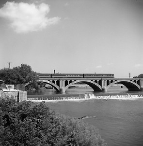 2018.008.IC.PD.02062--bruce meyer 120 neg--ICRR--obs on hind end of northbound passenger train Green Diamond crossing bridge--Kankakee IL--1958 0803