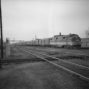 2018.008.IC.PD.00328--bruce meyer 120 neg--ICRR--EMD diesel locomotive 4010 on 2nd section of passenger train 6 Christmas special--Champaign IL--1955 1210