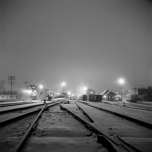 2018.008.IC.PD.01867--bruce meyer 120 neg--ICRR--northbound passenger train 2 City of New Orleans at station night scene 0940pm--Champaign IL--1958 1221