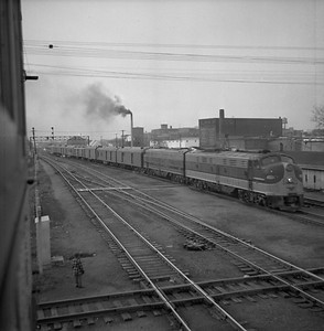 2018.008.IC.PD.00329--bruce meyer 120 neg--ICRR--EMD diesel locomotive 4031 on passenger train 10 The Seminole--Champaign IL--1955 1210