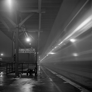 2018.008.IC.PD.01871--bruce meyer 120 neg--ICRR--EMD diesel locomotive 4022 on northbound passenger train 2 City of New Orleans at station night scene departing action--Champaign IL--1958 1221