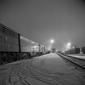 2018.008.IC.PD.01870--bruce meyer 120 neg--ICRR--EMD diesel locomotive 4022 on northbound passenger train 2 City of New Orleans at station night scene 0940pm--Champaign IL--1958 1221