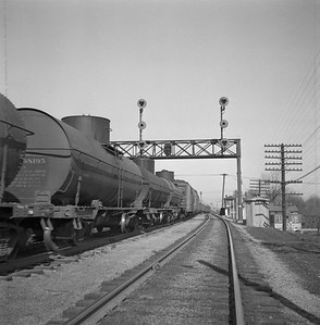 2018.008.IC.FD.0385--bruce meyer 120 neg--ICRR--Extra 9078 South freight train scene at signal bridge--Champaign IL--1956 0218