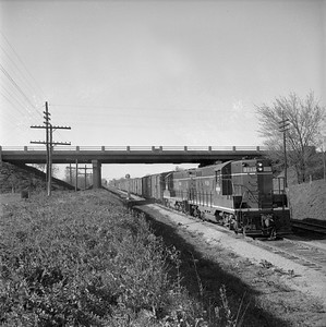 2018.008.IC.FD.0879--bruce meyer 120 neg--ICRR--EMD diesel locomotive 9116 on extra southbound freight train scene--Bloomington IL--1957 0504