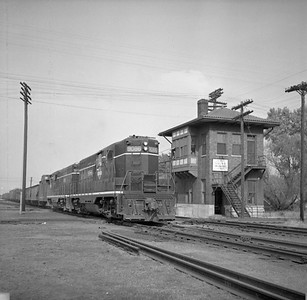 2018.008.IC.FD.0582--bruce meyer 120 neg--ICRR--EMD diesel locomotive 9086 on extra southbound freight train passing interlocking tower--Champaign IL--1956 1019