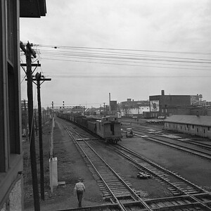 2018.008.IC.FD.1920--bruce meyer 120 neg--ICRR--caboose on hind end of 9009 South freight train scene--Champaign IL--1958 0503