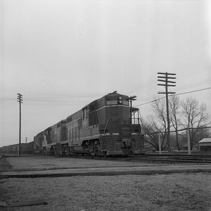 2018.008.IC.FD.1872--bruce meyer 120 neg--ICRR--EMD diesel locomotive 9160 on southbound freight train--Champaign IL--1958 0308