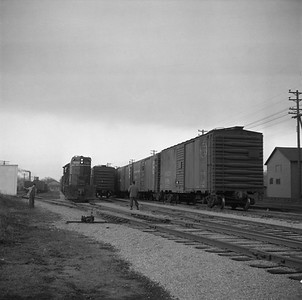 2018.008.IC.FD.0817--bruce meyer 120 neg--ICRR--EMD diesel locomotive 9189 switching freight cars in yard scene--Bloomington IL--1957 0227