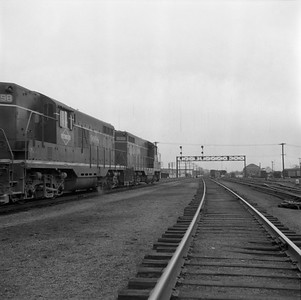 2018.008.IC.FD.1873--bruce meyer 120 neg--ICRR--EMD diesel locomotive 9160 on southbound freight train scene--Champaign IL--1958 0308