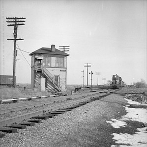 2018.008.IC.Z.0007--bruce meyer 120 neg--ICRR--Dean interlocking tower with approaching P&E freight train--Bloomington IL--1954 0000