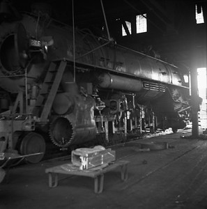 2018.008.IC.S.0212--bruce meyer 120 neg--ICRR--steam locomotive 2-10-2 2816 under repair inside roundhouse--Paducah KY--1955 0600