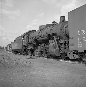 2018.008.IC.S.0146--bruce meyer 120 neg--ICRR--steam locomotive 2-8-2 1651 switching in yard scene--Bloomington IL--1954 0000