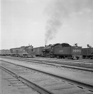 2018.008.IC.S.0577--bruce meyer 120 neg--ICRR--steam locomotive 2-8-2 1691 yard scene with diesel--Champaign IL--1956 1018
