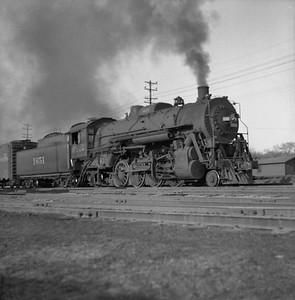 2018.008.IC.S.0144--bruce meyer 120 neg--ICRR--steam locomotive 2-8-2 1651 on freight train action--Bloomington IL--1954 0000