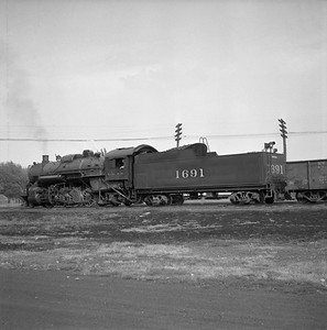 2018.008.IC.S.0585--bruce meyer 120 neg--ICRR--steam locomotive 2-8-2 1691 in yard--Champaign IL--1956 1019