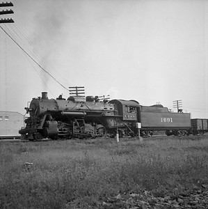 2018.008.IC.S.0584--bruce meyer 120 neg--ICRR--steam locomotive 2-8-2 1691 in yard--Champaign IL--1956 1019