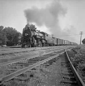 2018.008.IC.S.0270--bruce meyer 120 neg--ICRR--steam locomotive 2-8-2 1668 on southbound freight train action--Champaign IL--1955 0700