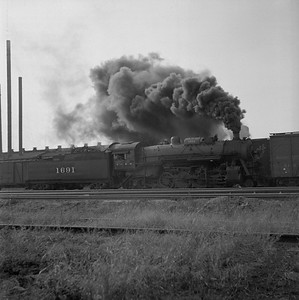2018.008.IC.S.0576--bruce meyer 120 neg--ICRR--steam locomotive 2-8-2 1691 yard scene action--Champaign IL--1956 1018