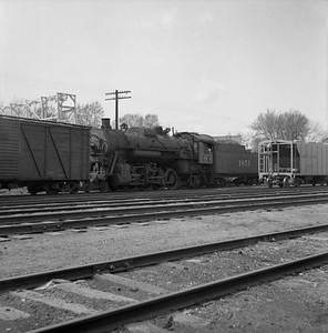 2018.008.IC.S.0145--bruce meyer 120 neg--ICRR--steam locomotive 2-8-2 1651 switching in yard scene--Bloomington IL--1954 0000