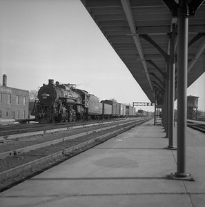 2018.008.IC.S.0161--bruce meyer 120 neg--ICRR--steam locomotive 2-8-2 1668 on northbound freight train at station platform--Champaign IL--1955 0000
