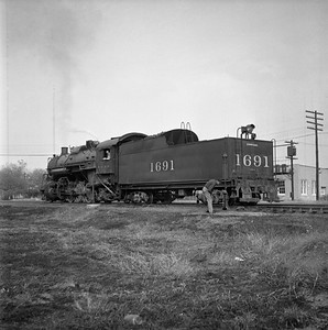 2018.008.IC.S.0588--bruce meyer 120 neg--ICRR--steam locomotive 2-8-2 1691 rear tender view in yard--Champaign IL--1956 1019