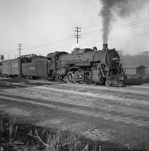 2018.008.IC.S.0147--bruce meyer 120 neg--ICRR--steam locomotive 2-8-2 1651 on freight cars in yard action--Bloomington IL--1954 0000