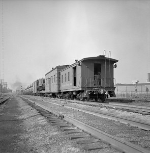2018.008.IC.S.0271--bruce meyer 120 neg--ICRR--wooden caboose on hind end of freight train--Champaign IL--1955 0700