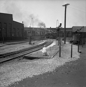 2018.008.IC.S.0236--bruce meyer 120 neg--ICRR--steam locomotive 2-8-2 2137 on turntable at roundhouse scene--Paducah KY--1955 0600