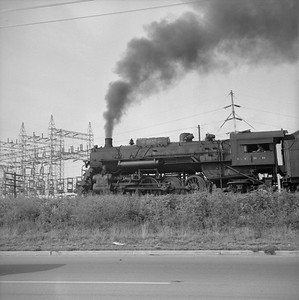 2018.008.IC.S.1167--bruce meyer 120 neg--ICRR--steam locomotive 2-8-2 2138 on eastbound freight train action--Paducah KY--1957 0716